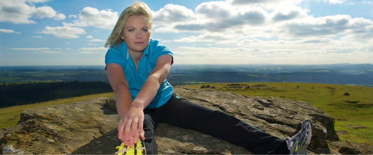 Emily Whitehead stretching exercise on Dartmoor - Improve Your Health, Wellbeing and Energy Levels